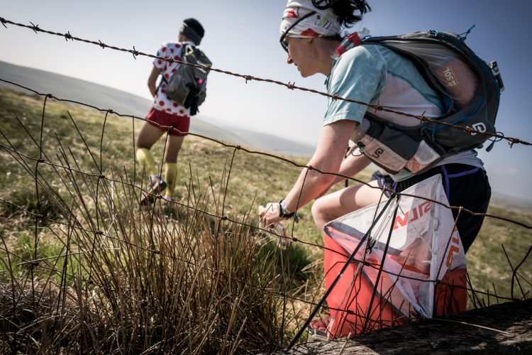2 Carol Morgan ticks off another check point on day four of the Berghaus Dragon's Back Race - photo Ciancorless.com