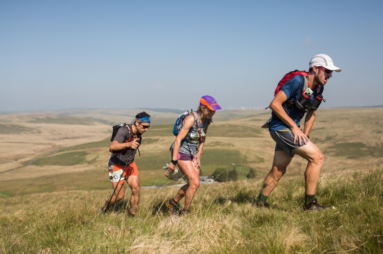 3 Caroline Mcllroy heads uphill with two other runners on day four of the Berghaus Dragon's Back Race - photo guillemcasanova.com