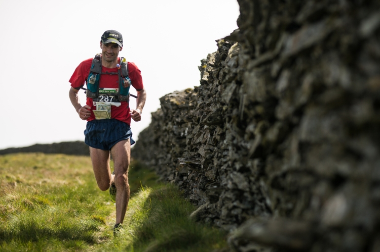 4 Jim Mann enjoys day two of the Berghaus Dragon's Back Race - photo guillemcasanova.com