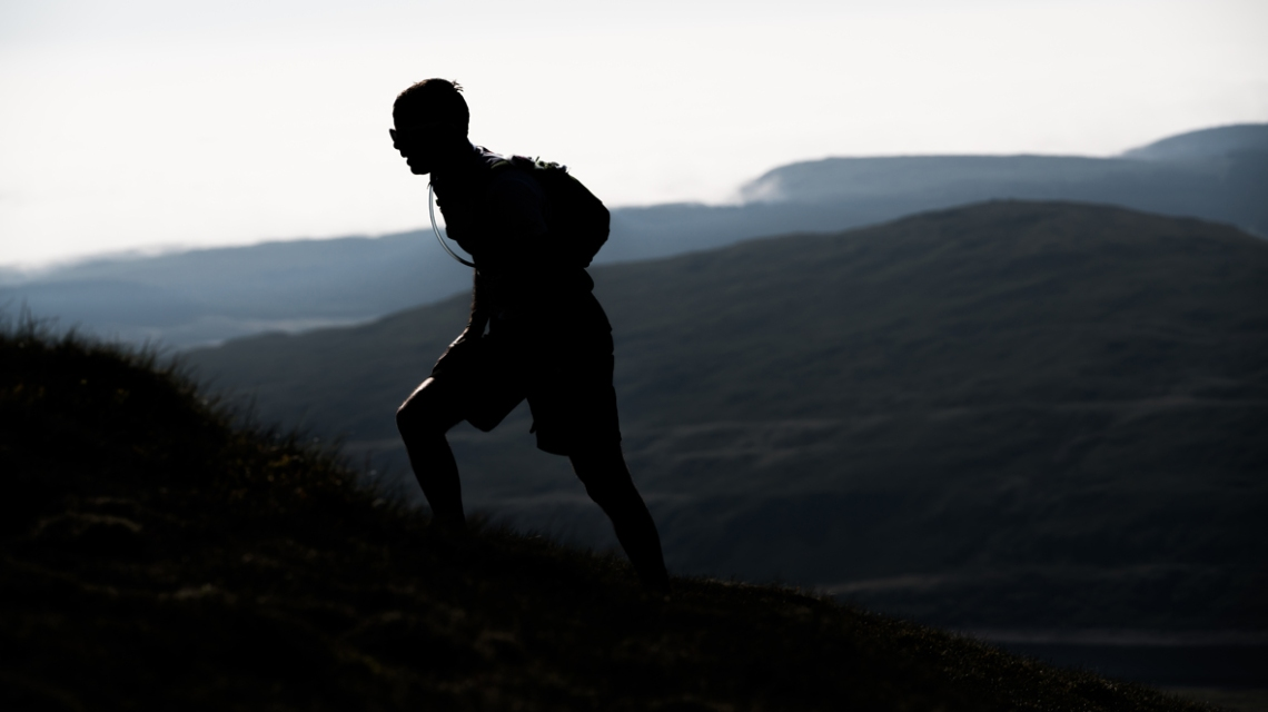 7 A runner in silhouette on day three of the Berghaus Dragon's Back Race - photo Ciancorless.com